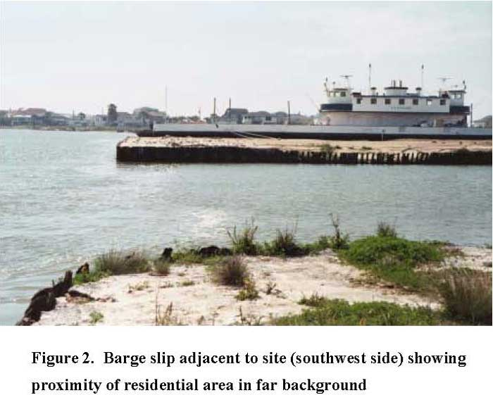 Barge slip adjacent to site (southwest side) showing proximity of residential area in far background