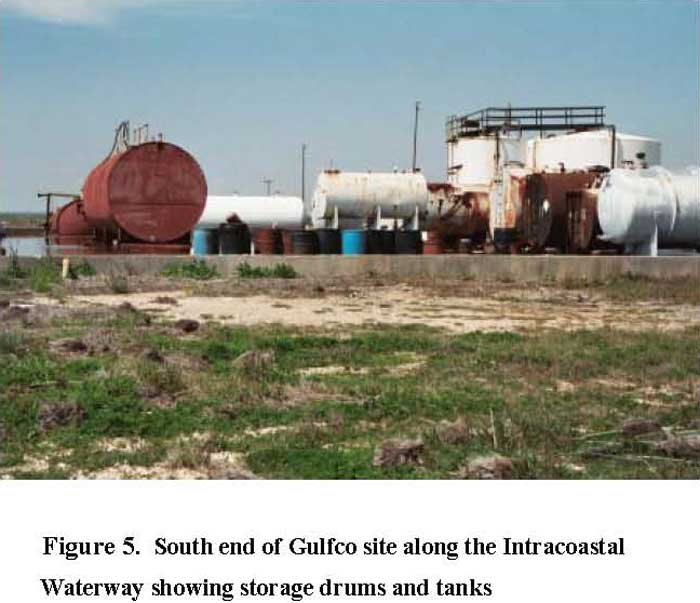 South end of Glufco site along the Intracoastal Waterway showing storage drums and tanks