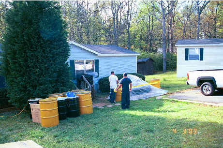 Mercury contaminated household items undergoing remediation and/or disposal preparation at the Mohican Maze residence.