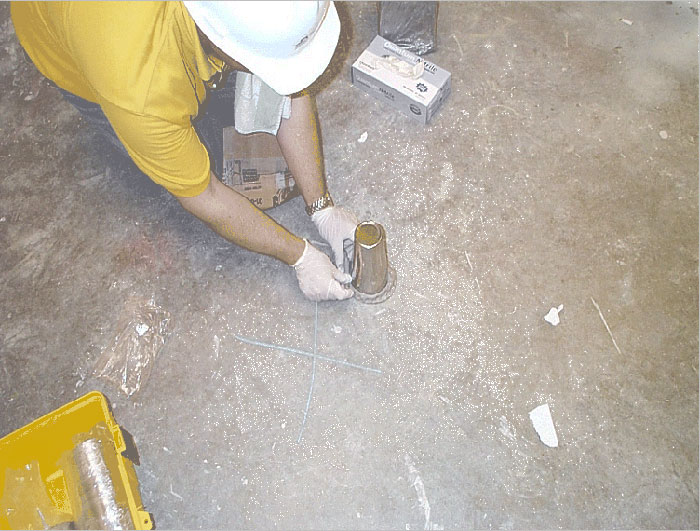 Photo of Emflux sampling over concrete floor at Downtown School