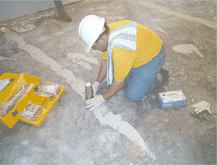 Photo of Emflux sampling over patched concrete floor at Downtown School