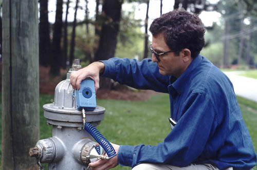 Image 5: Photo showing Radcom Log-Log LL pressure recorder used to attach to fire hydrant to record continuous pressure values needed for water-distribution system model calibration, May 19, 2004.
