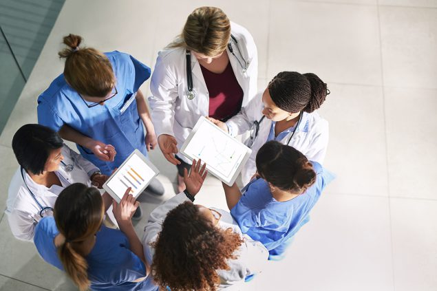 Healthcare professionals in a circle in active consult