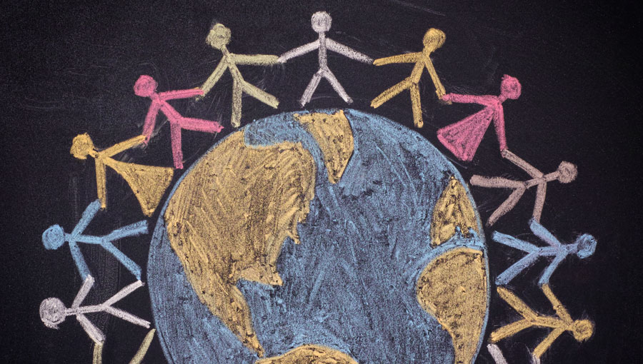 color chalk drawing of a globe with stick figures of children holding hands around it